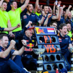 Max Verstappen celebrating with Red Bull Racing.