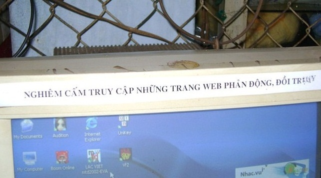 "A warning to customers at an Internet cafe in Thu Duc, Ho Chi Minh City, Vietnam. The message taped along the top of the monitor warns against accessing ""depraved"" or ""reactionary"" materials online."